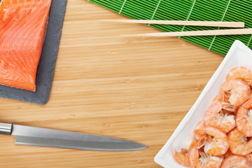 Fresh sea food and kitchen utensils