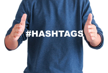 The hands of men with text hashtags