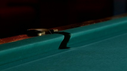 Cue hits red pool ball