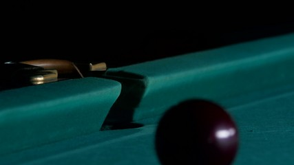 White ball falls into a pocket billiard after impact
