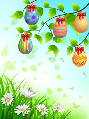 Colorful easter eggs hanging on branches