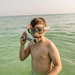 young boy starts snorkeling