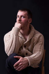 Portrait of handsome and young man in sweater
