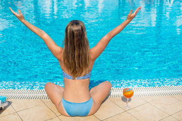 young woman relaxing on the pool