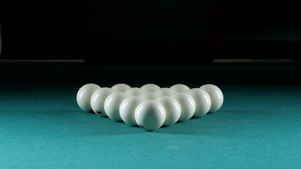 Triangle forms a pyramid of billiard balls