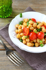 Salad with chickpeas and tomatoes on a bowl