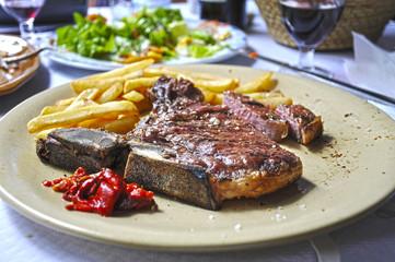 T-bone steak and fries