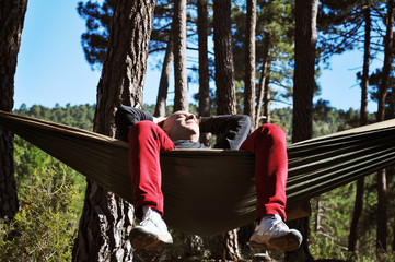 Spanish man resting in a hammock in the forest