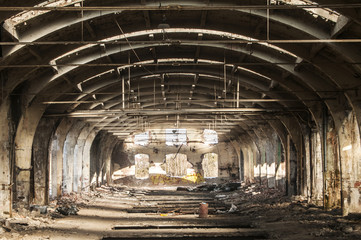 Old abandoned decayed grunge hall of vintage railway plant