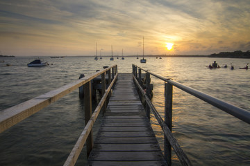 Sunset on jetty at beach at Rockley Park