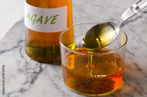 Agave syrup pouring on a glass. - 78720736