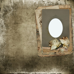 Old frame with roses faded on a  vintage shabby background