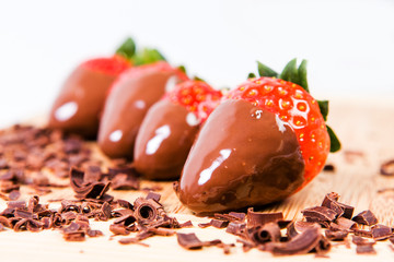 Ripe strawberries dipped in chocolate.
