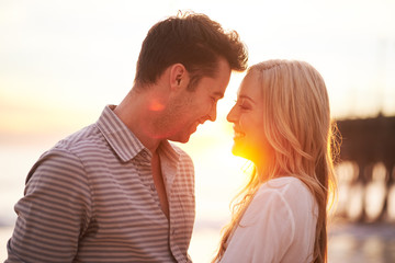 romantic couple at sunset about to kiss