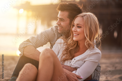 canvas print picture two lovers at santa monica beach holding each other