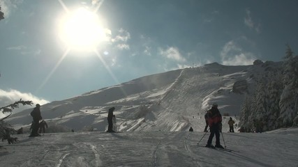 Ski resort in Stara Planina with skiers and sun
