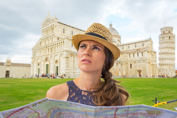 Young woman with map on piazza dei miracoli, pisa, tuscany