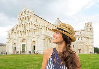 Portrait of happy young woman in front of duomo di pisa, pisa