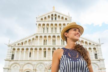Happy young woman in front of duomo di pisa, pisa, tuscany