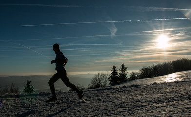 Running silhouette in winter