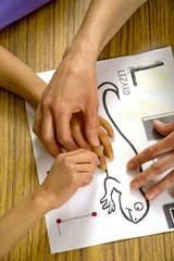 blind child's hands over outline of lizard
