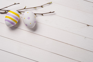 Colorful Easter eggs with branches of cherry on a background of
