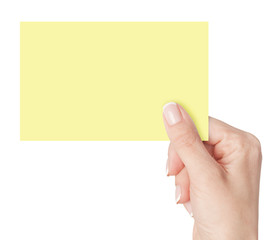 Women's fingers holding a blank business card