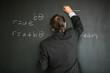 Senior male teacher teaching mathematics