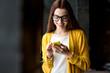 Leinwanddruck Bild - Woman using phone