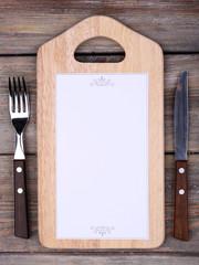 Cutting board with menu sheet of paper
