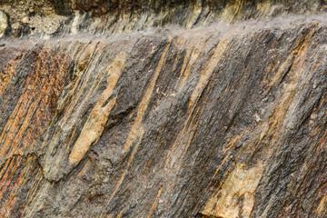 gray rock inside a tunnel