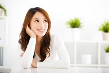 beautiful young asian woman thinking something