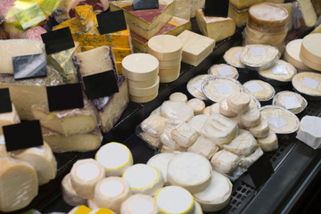 Market counter with fresh cheese kinds