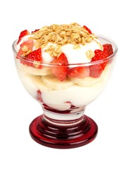 Strawberry and banana yogurt parfait in a glass isolated