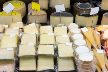 Fresh cheese in packs and in bulk on counter