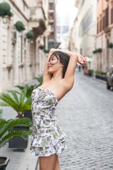 Beautiful sexy asian woman relaxed posing in urban scene