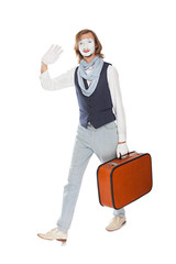 actor mime waves his hand with orange suitcase