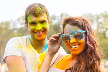 Portrait of happy couple on holi color festival
