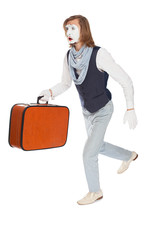 mime actor running with a suitcase in his hand