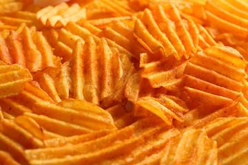 Delicious potato chips closeup background