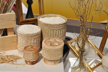 Various sticky rice in baskets with dry tree and photo frame, st