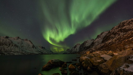 Northern Lights over fjords in Norway coast