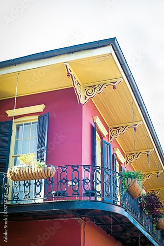 Corner of red home with balcony in French Quarter of New Orleans