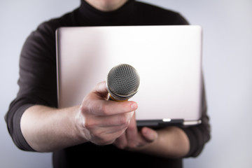 Male hand with microphone