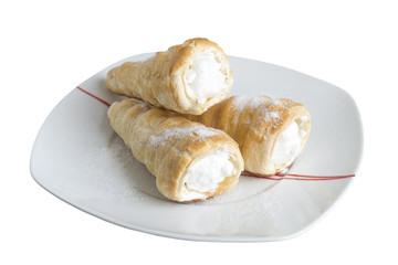 custard cakes isolated on white background