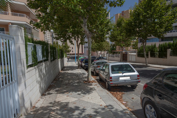 Quiet street with parked cars. Calpe, Spain.