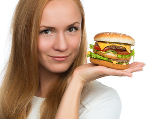 Woman hold tasty unhealthy burger sandwich in hands hungry