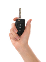 Hand with car key isolated