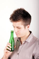 Boy with green bottle
