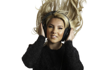 Girl Flinging Hair Listening Headphones Isolated Background